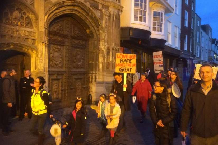 The protesters march past Canterbury Cathedral.