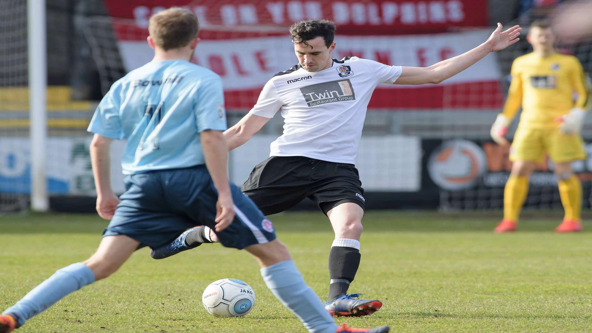 Danny Harris plays the ball forward for Dartford. Picture: Andy Payton