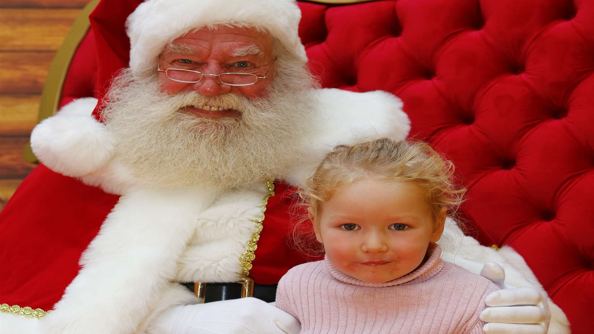 Father Christmas with Ellie Rocamora, aged three, at the Festive Family fun day at Royal Victoria Palace, Tunbridge Wells.