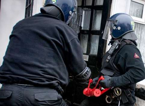 Police force their way into a property. Stock image: Kent Police