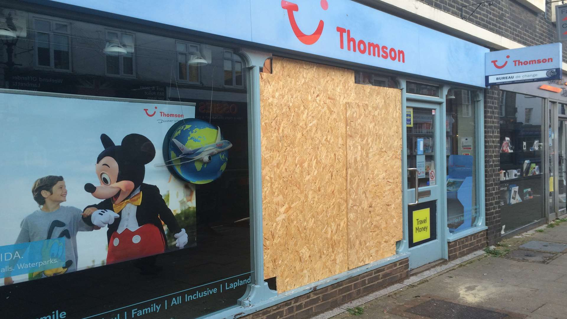 Thomson travel agents had its window damaged.