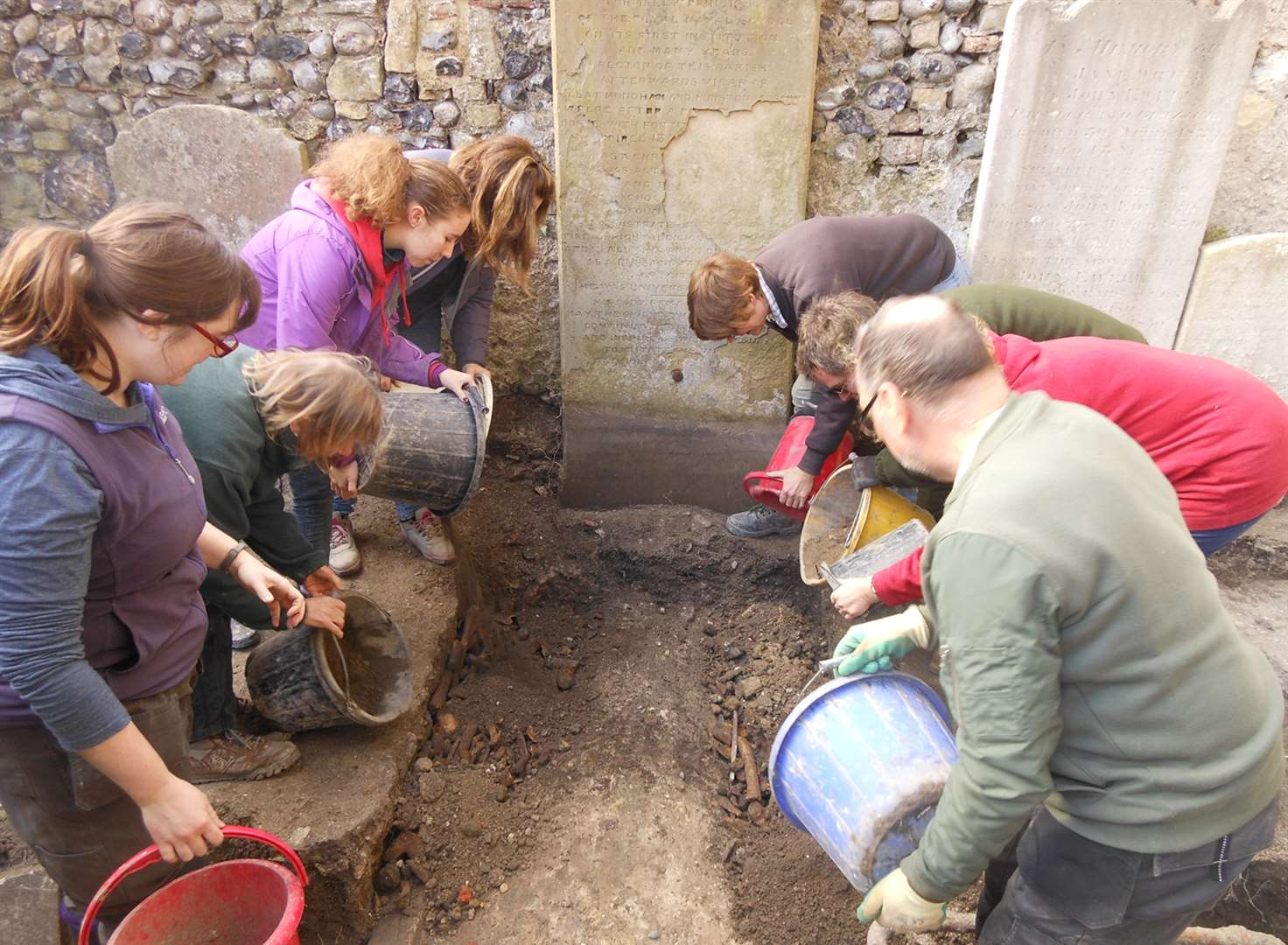 Bones, coins and pottery unearthed at church dig