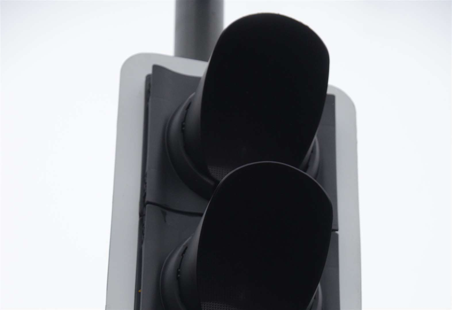 Traffic lights out on busy road