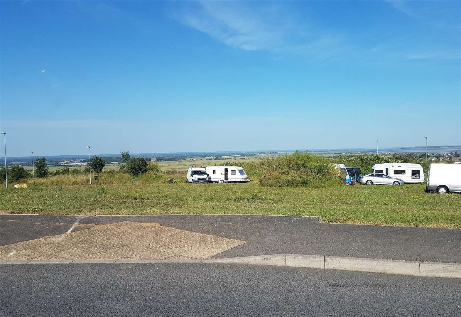 Travellers pitch up on 'dangerous' building site