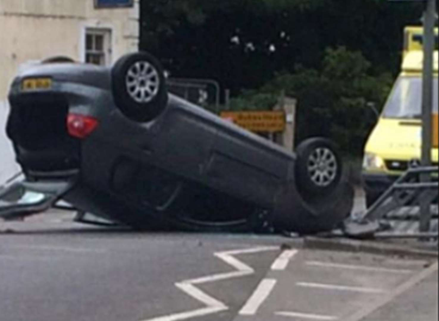 Road closure after car ends up on roof