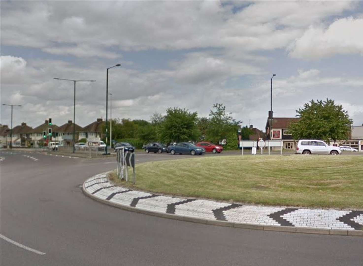 Crash on roundabout as police pursue car