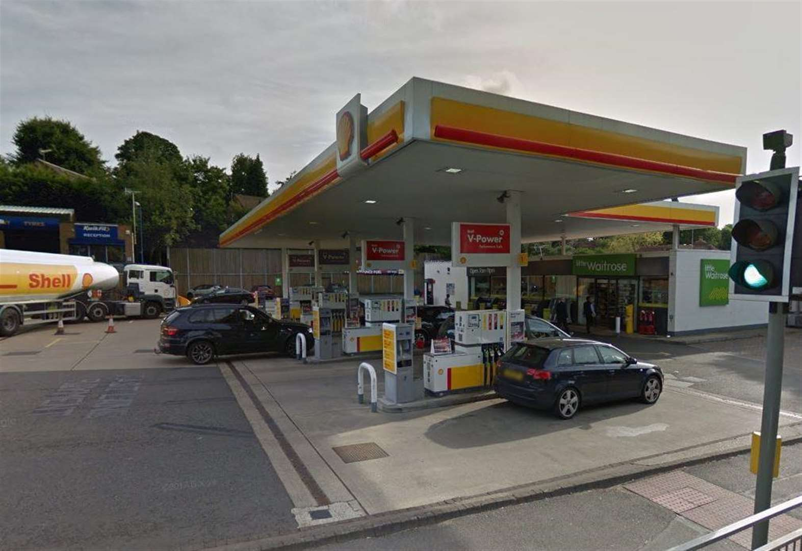Man accused of racially abusing staff at petrol station store