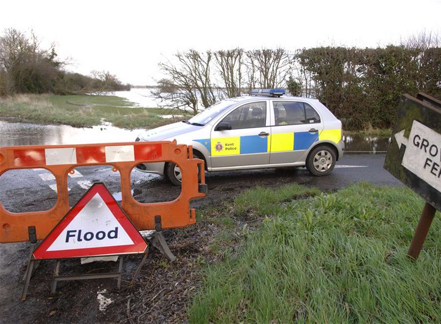 Trio rescued from car stuck in flooding after ignoring road closure sign