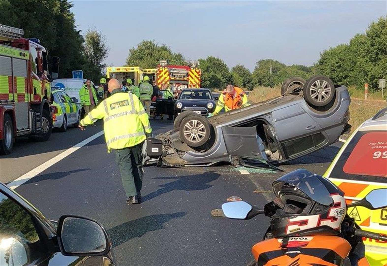 Delays as car overturns