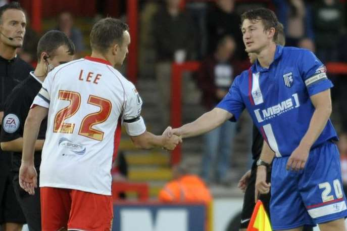 Callum Davies shakes hands with his former Gills team-mate Charlie Lee before kick-off
