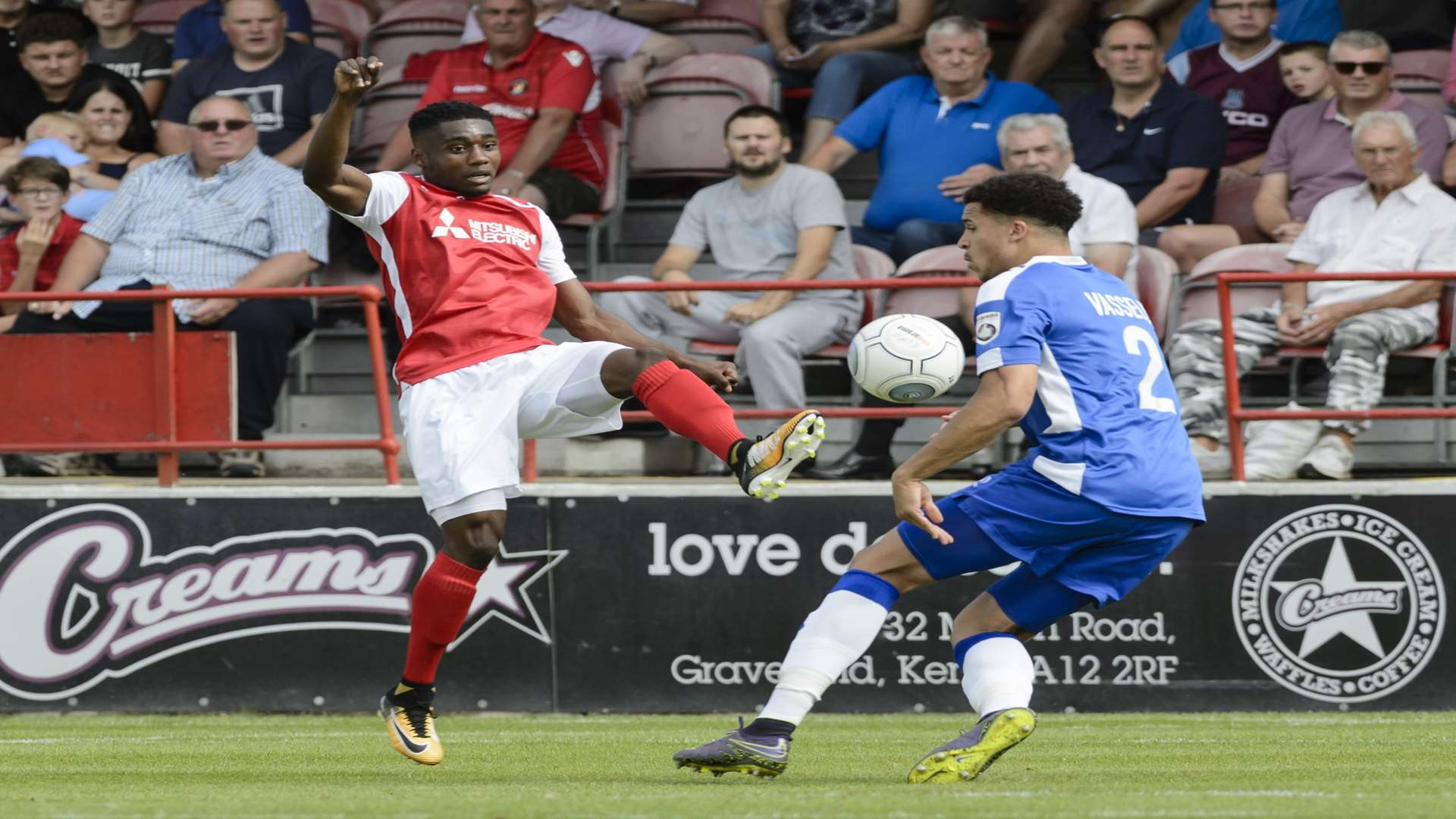 Darren McQueen gets no change out of Theo Vassell Picture: Andy Payton