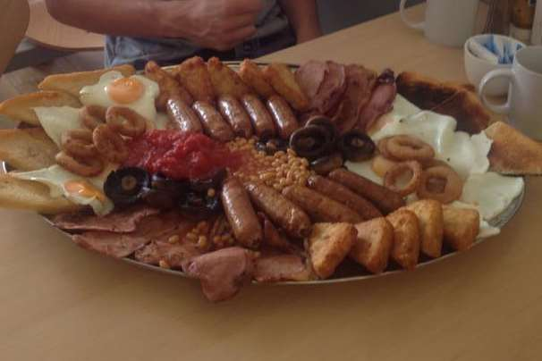 Ollie Williams, a customer of Papa Joe's Cafe in St Michael's with the 10Terden Terminator mega fry-up.