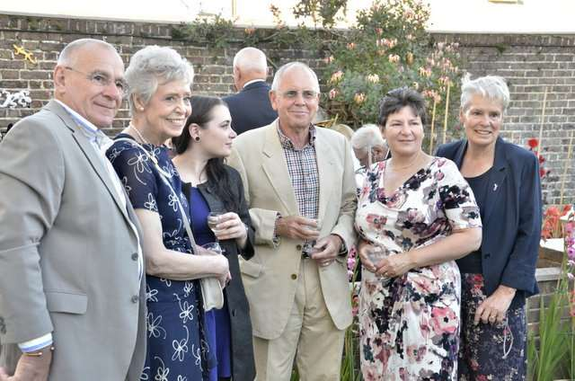 Members of Sir Vician Dunn's family with the present residents of the house, Paul and Sue Le Chevalier