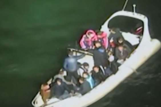 Footage from the coastguard helicopter shows passengers bailing water from the packed boat