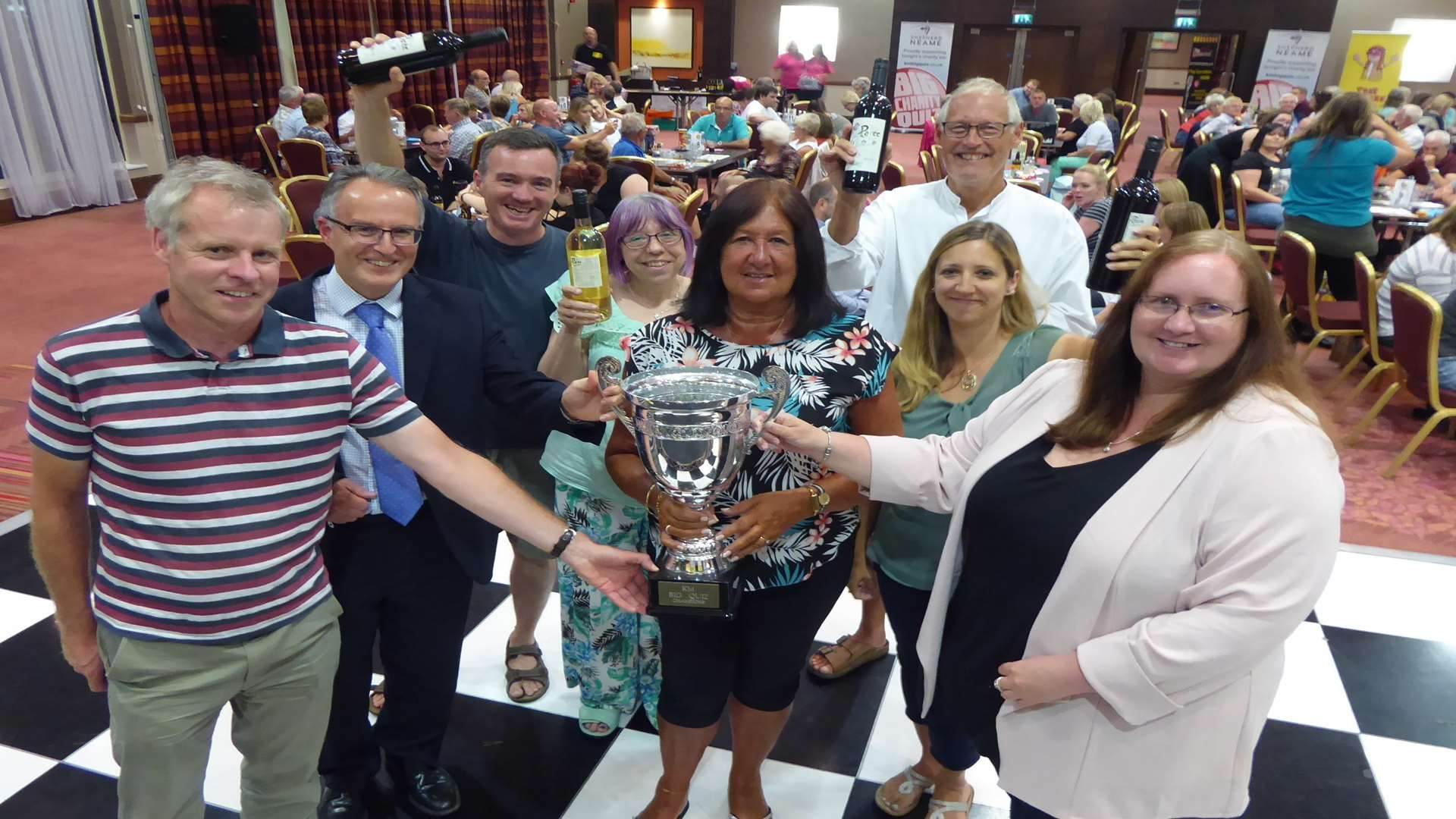 Moomins receive Ashford KM Big Charity Quiz trophy from David Fifield of Hallett and Co, Clive Perry of Specsavers and Rebecca Naylor of Ashford International Hotel.