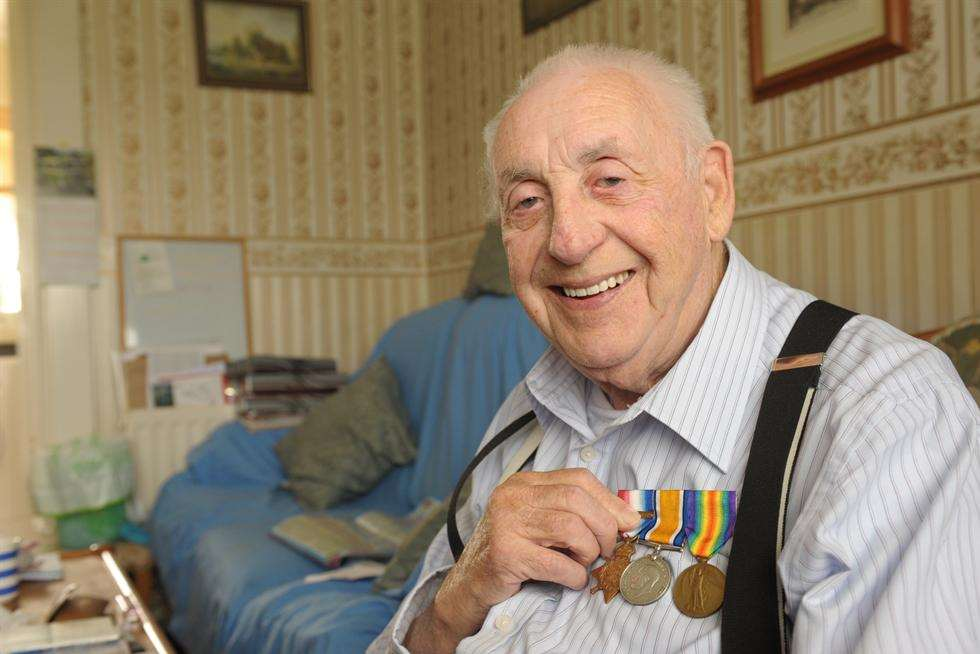 John Stewart with his dad's WW1 medals
