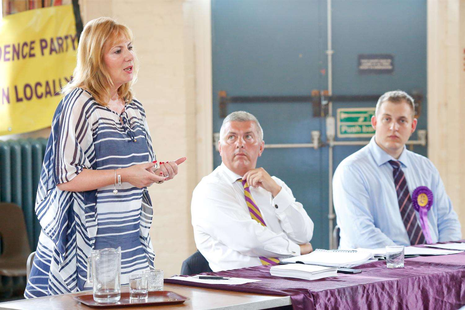MEP Janice Atkinson addresses the meeting, watched by Cllr Eddie Powell and Jamie Kalmar