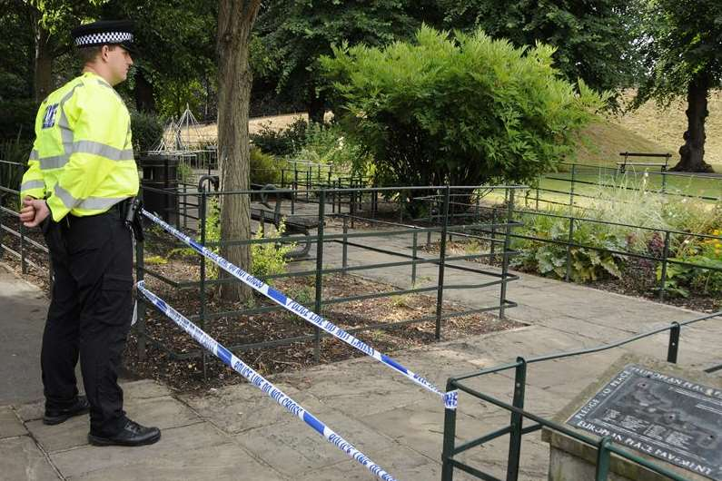 A policeman guards the scene in Dane John Gardens in Canterbury