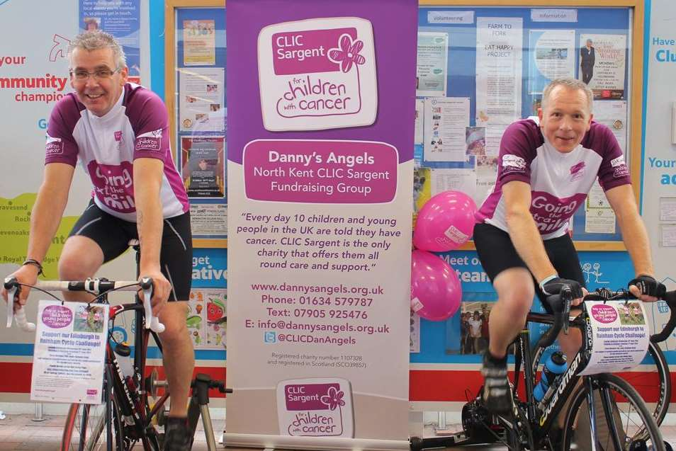 Tony and Nick on static bikes in Tesco, Gillingham
