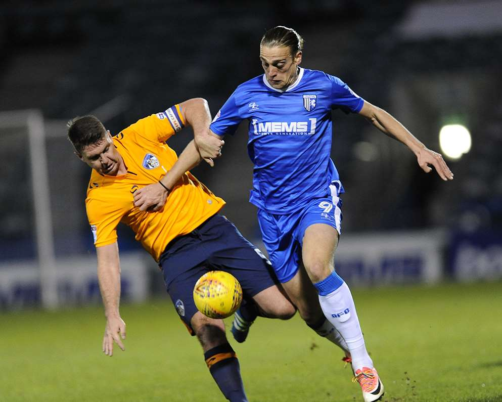 Gills striker Tom Eaves keeping the Oldham defence busy Picture: Ady Kerry