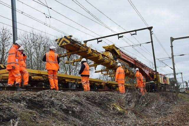 Network Rail staff will remove an overhanging tree from the railway near Wye. Stock image