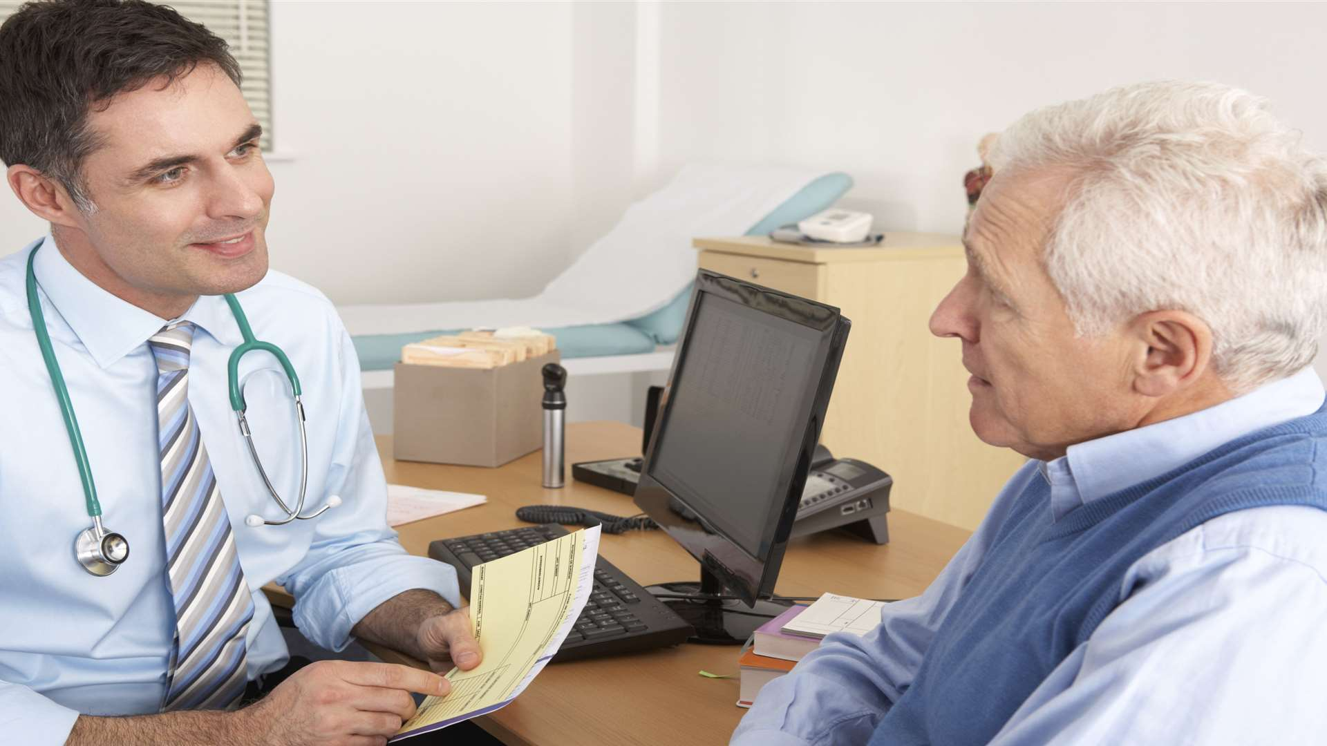 Stock picture of GP in a surgery with patient
