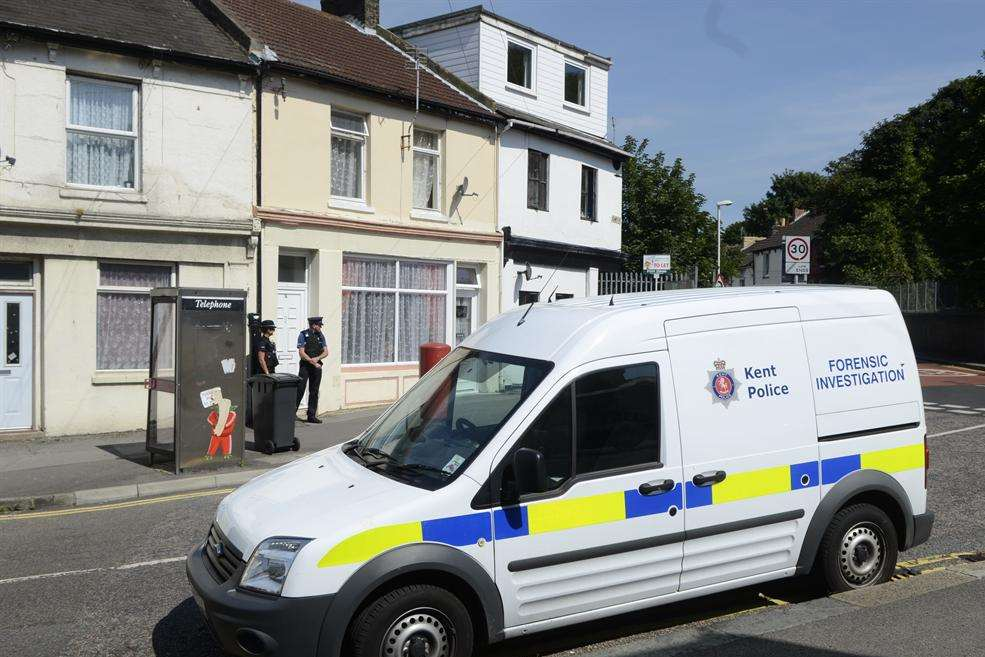 Police and Forensic officers outside the flat in East Street, Tower Hamlets, Dover