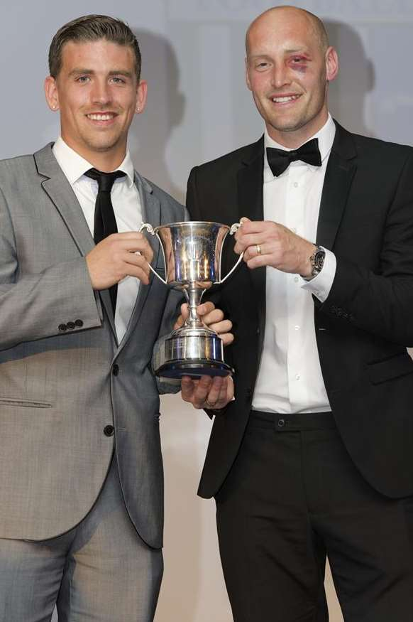 Players' player-of-the-year, Cody McDonald, left, receives his award from club captain Adam Barrett