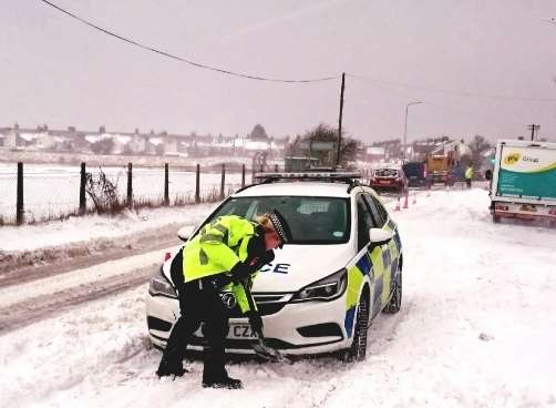Even police cars were stuck in the snow on the Halfway Road on Sheppey. Picture: Swale Police via Twitter