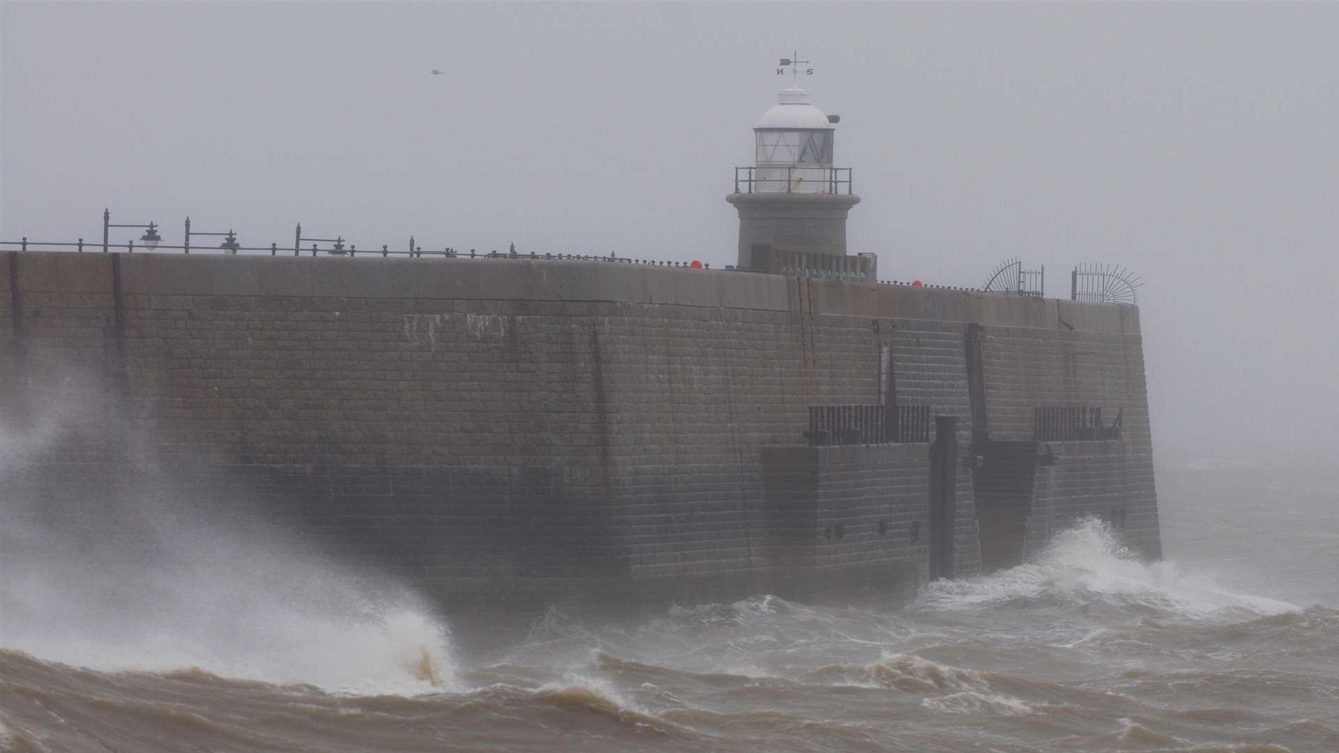Strong winds and large waves at Folkestone harbour. Library image.