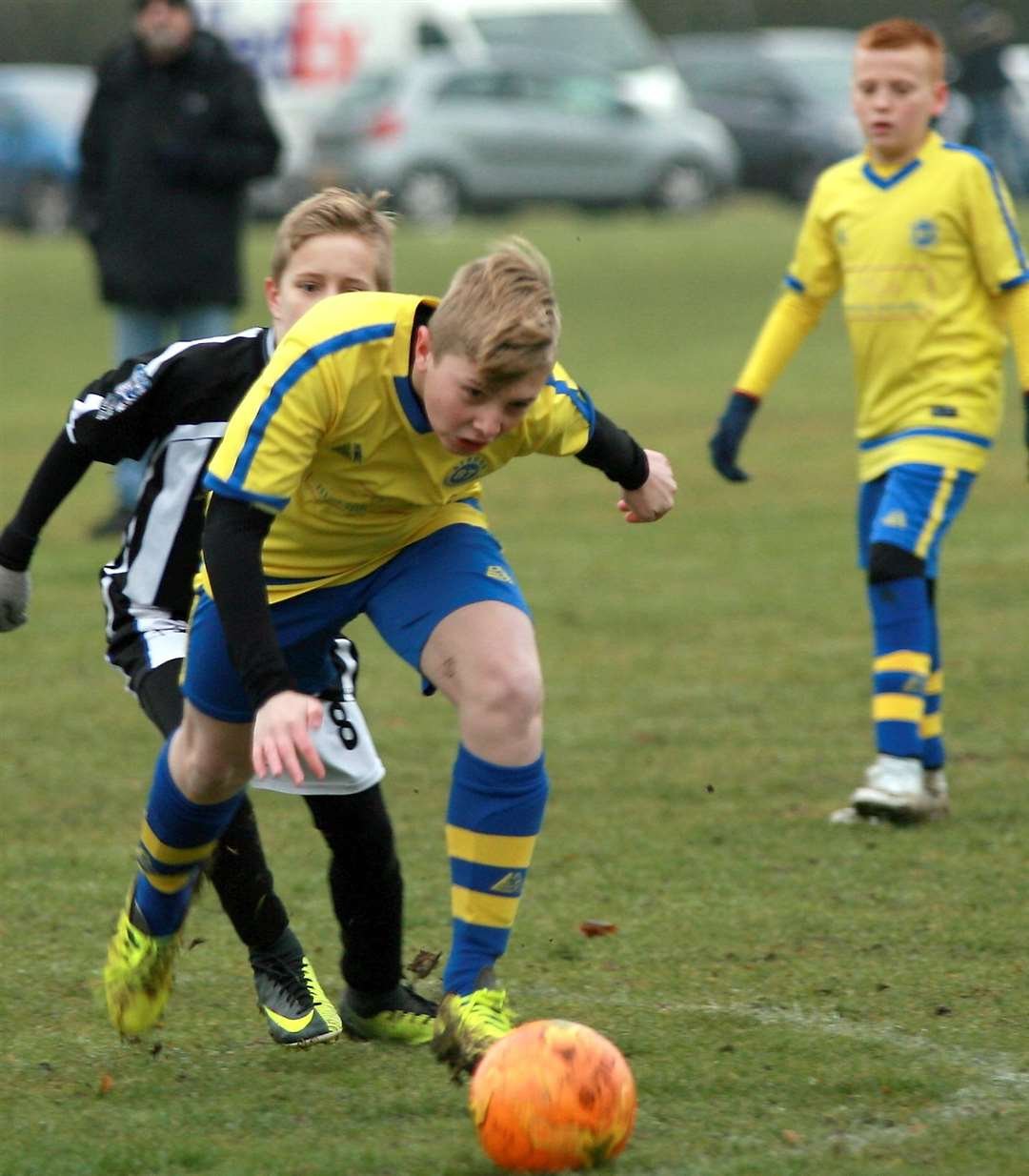 Strood 87 (yellow) and Milton & Fulston United battle for victory in Under-12 Division 2 Picture: Phil Lee