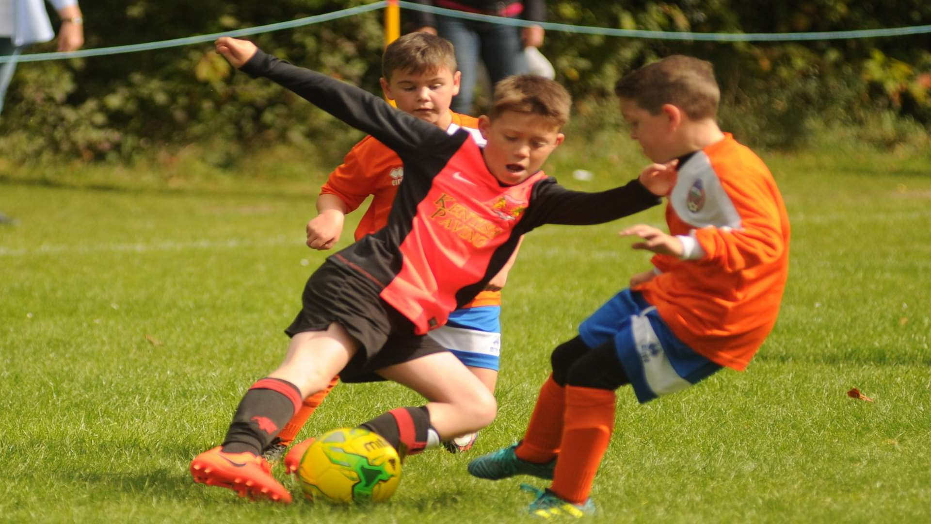 Cuxton 91 Dynamos under-10s (orange) and Woodcoombe Youth battle it out Picture: Steve Crispe