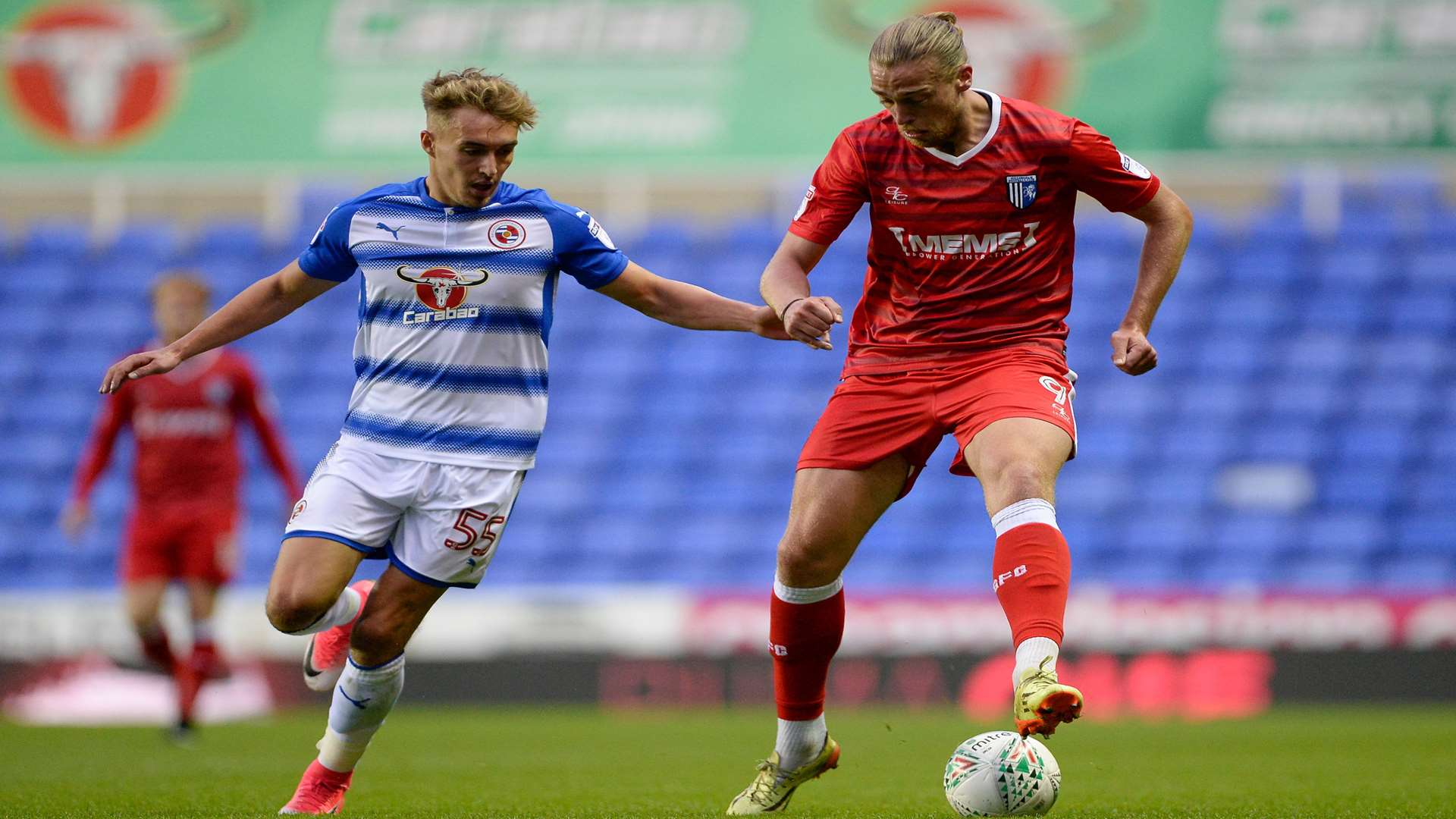 Tom Eaves on the ball as Reading's Sam Smith stays close Picture: Ady Kerry
