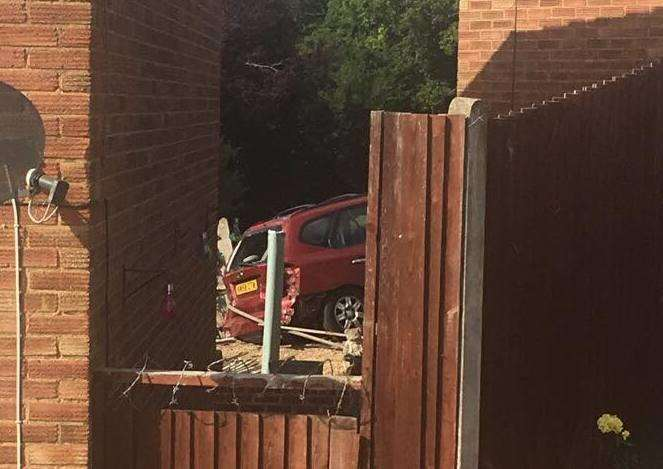 The car ending up ploughing thought a neighbour's fence, picture Logan Enfield