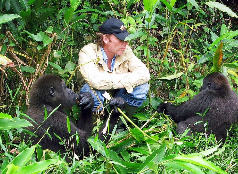 Conservationist Damian Aspinall with gorillas in Gabon in 2010