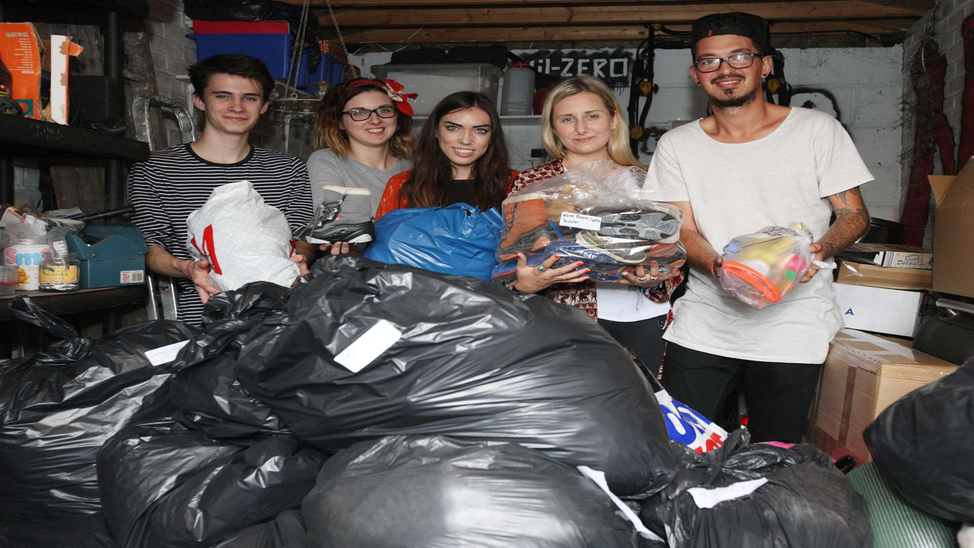 The group with some of the donated clothing. Picture: John Westhrop