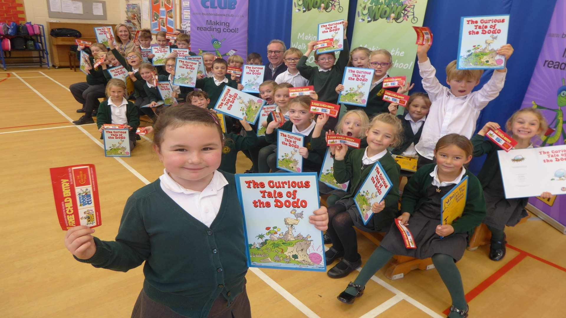 Whitstable author Anthony Cooper reads his book The Curious Tale of the Dodo to the winners of a walk to school contest: Hernhill C of E Primary School in Faversham. Front: Bella Jones, 6, with Year 2 Class.