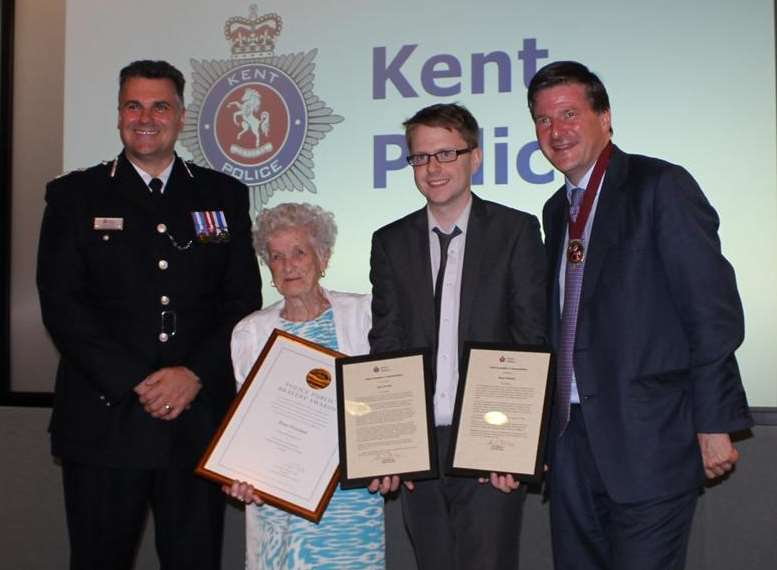 Rose Overland and her grandson Gary Yearley are presented with their bravery awards and merits by the Chief Constable of Kent Alan Pughsley and the High Sheriff of Kent Hugo Fenwick