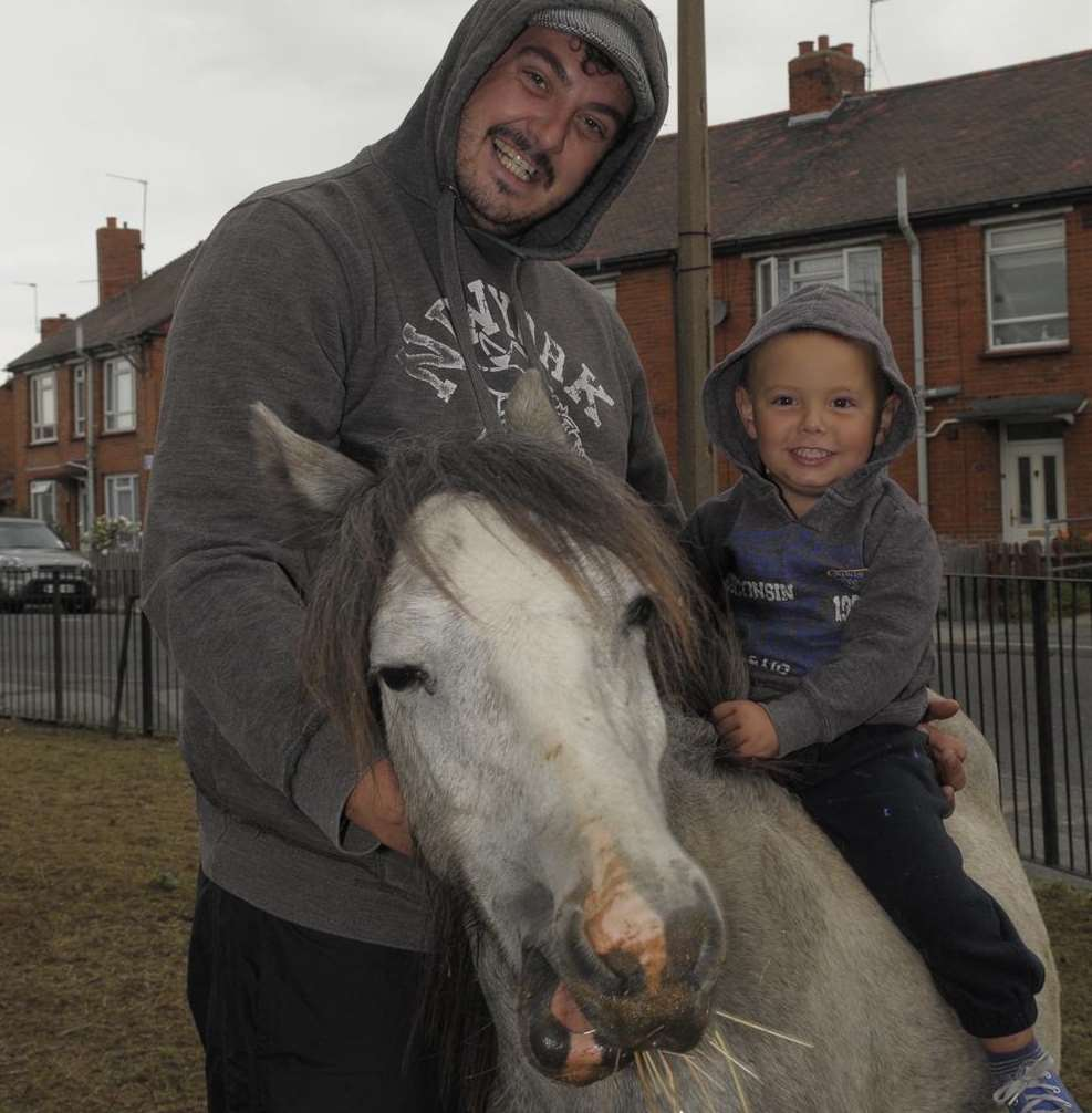 Aaron Trotter and his son Mason, two, on their horse
