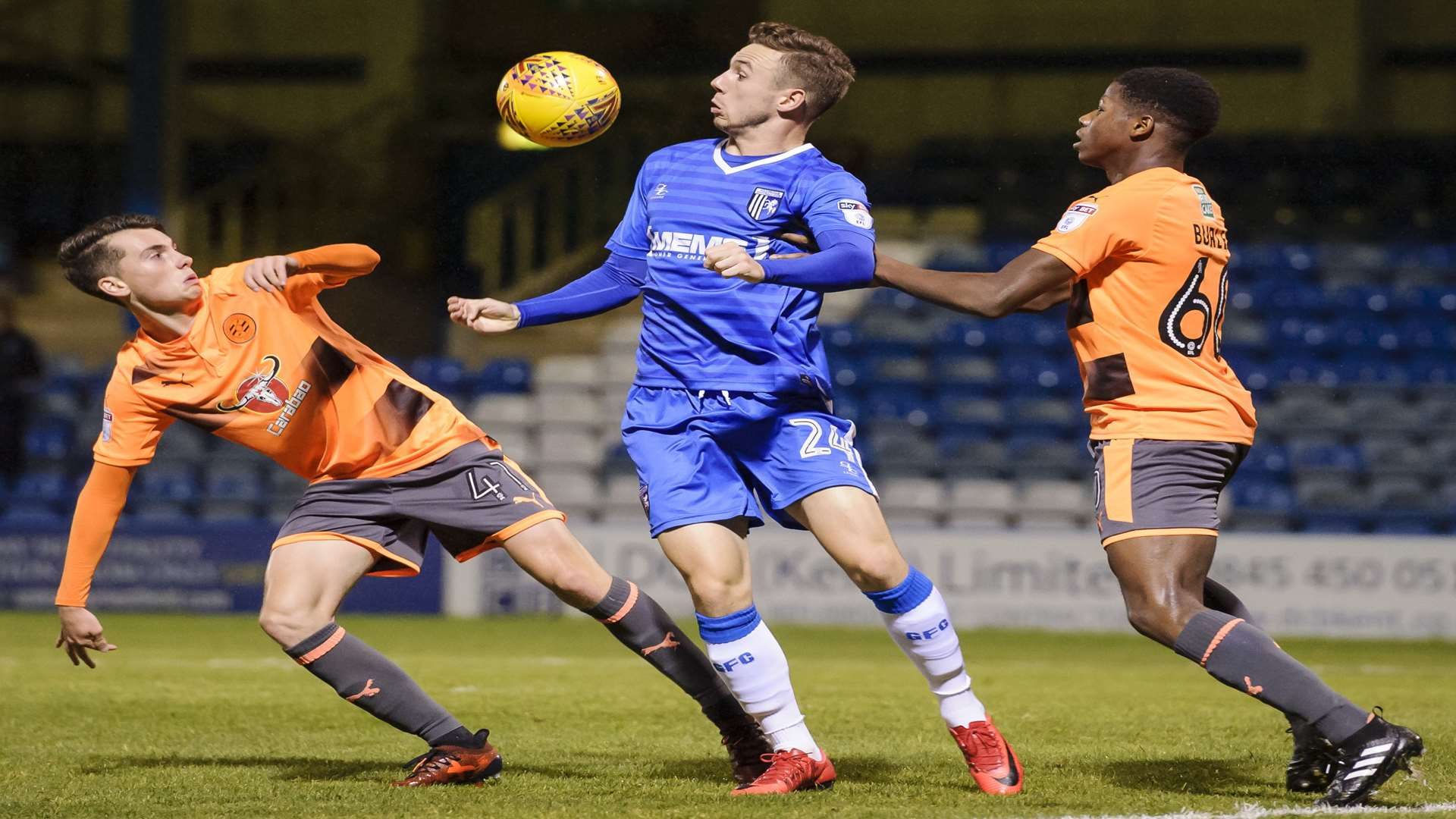 Gillingham's Greg Cundle battles for the ball against Reading. Picture: Andy Payton