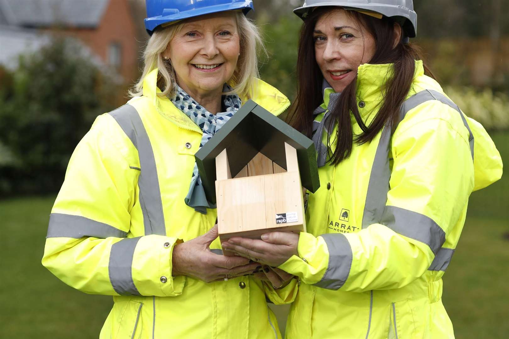 Barratt staff with one of the nest boxes fitted (1393378)