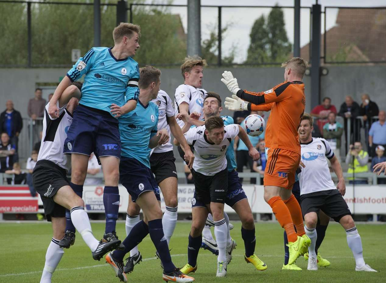 Players from both sides pile in as Dartford try to convert a corner Picture: Andy Payton