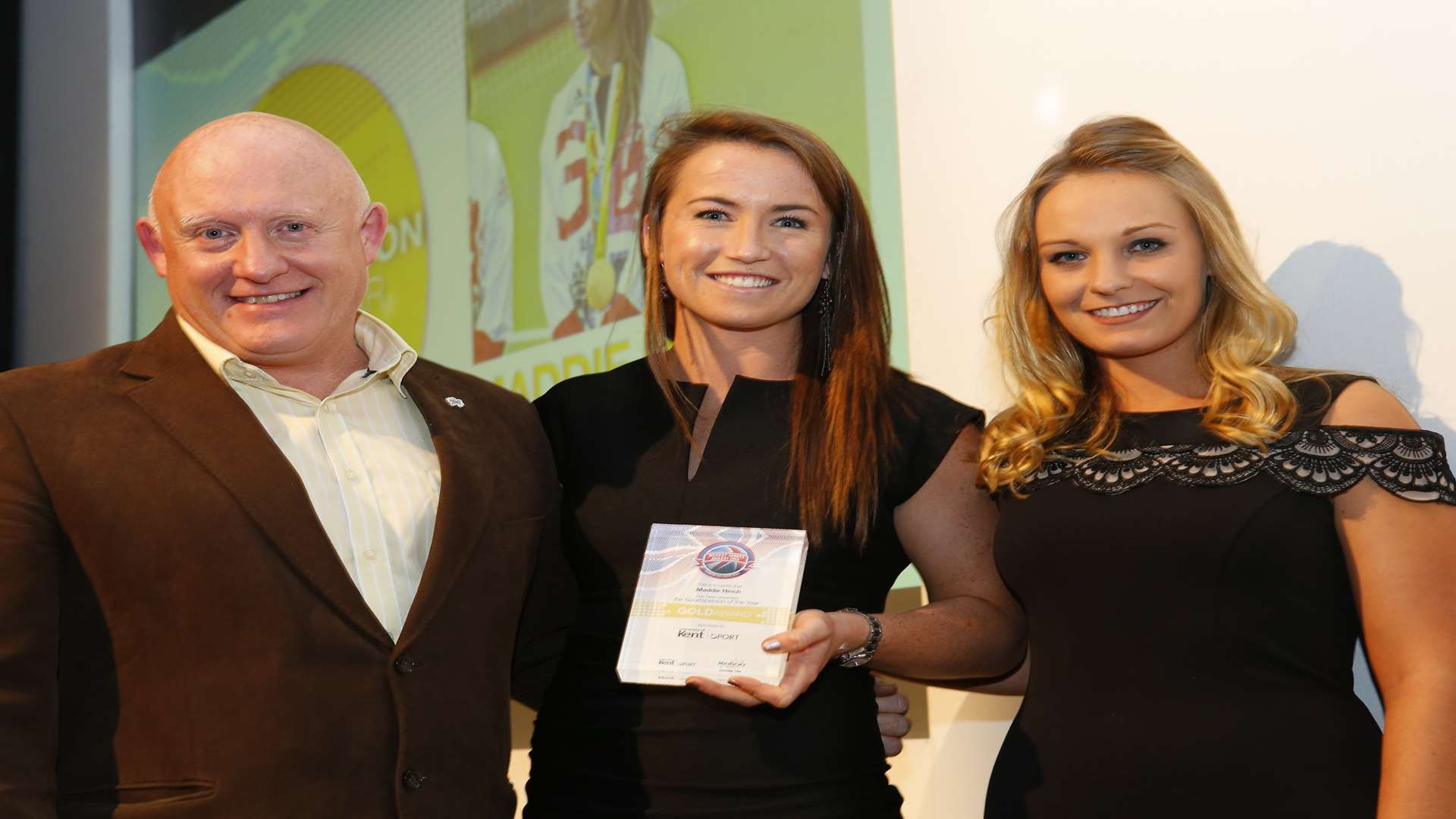 Maddie Hinch, centre, collects her award from University of Kent Sport's Graham Holmes and Charlotte Evans, the 2014 winner. Picture: Andy Jones