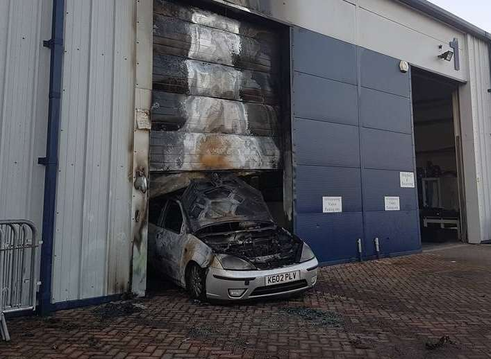 The car was set alight after being reversed into the gym's doors