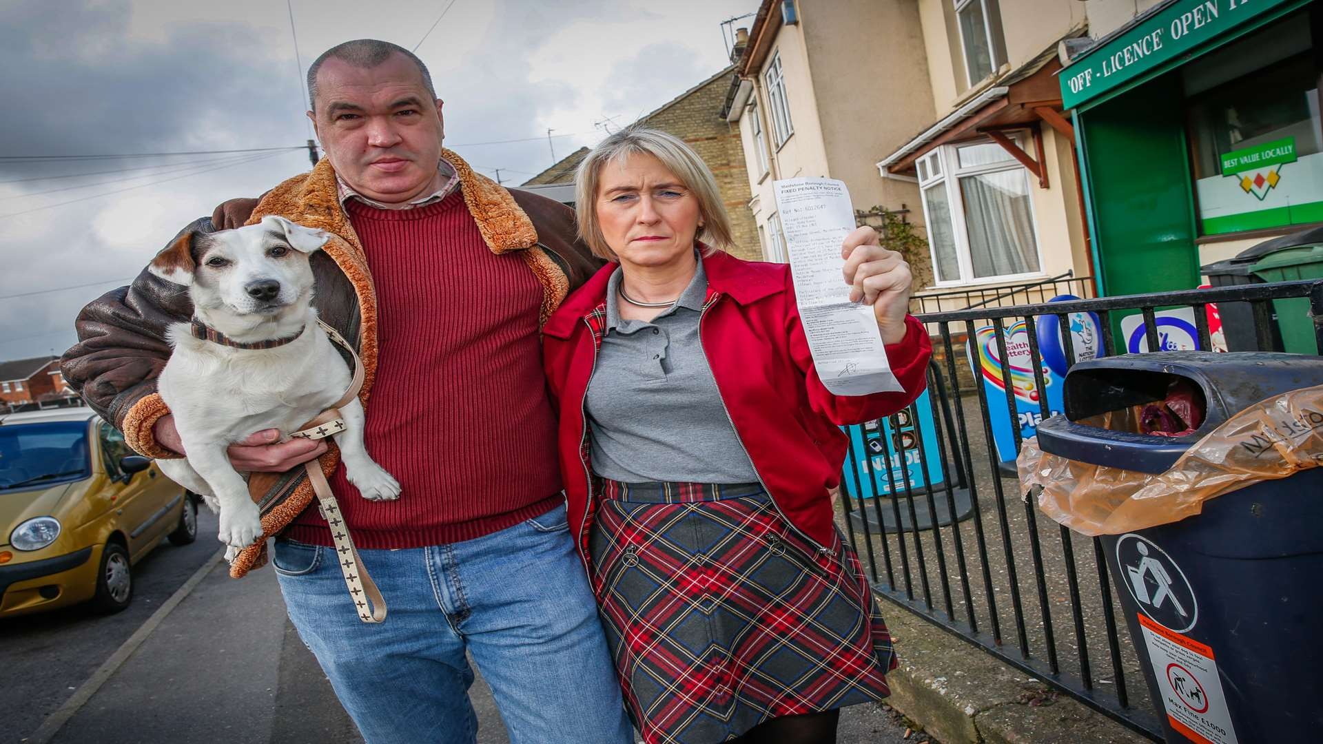 Amanda and Andy Evans with Digger the Jack Russell outside Manak Supermarket in Hartnup Street where they were fined for picking up dog mess and putting it in a litter bin