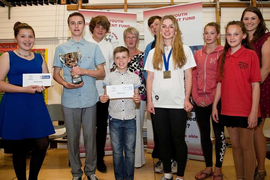 The nine youngsters who received Swale Youth Development Fund backing, with the charity's chairman, Carole Nealey
