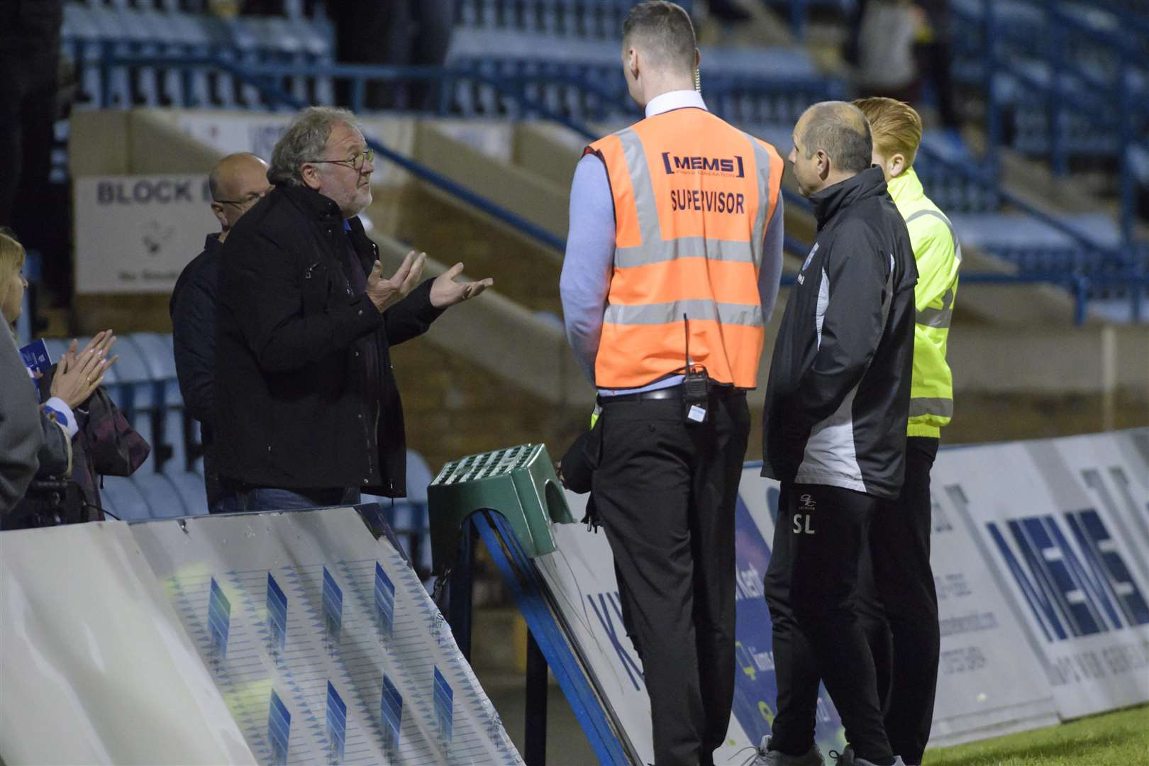 Manager Steve Lovell chats with a disgruntled fan after the whistle following Tuesday's defeat to Rotherham Picture: Andy Payton