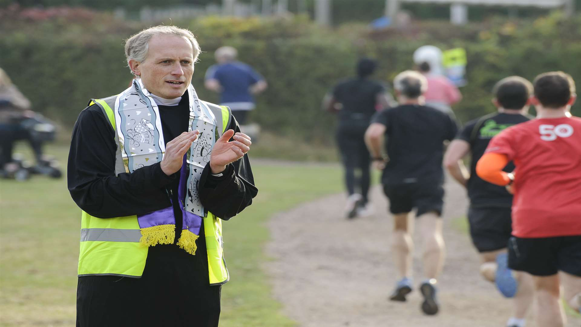 "'Vicar"" Jonathan Crowle cheers the runners on. Picture: Andy Payton"