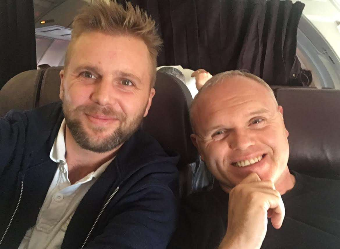 James Roberts with hypnotist Jason O'Callaghan on the plane. Picture: SWNS