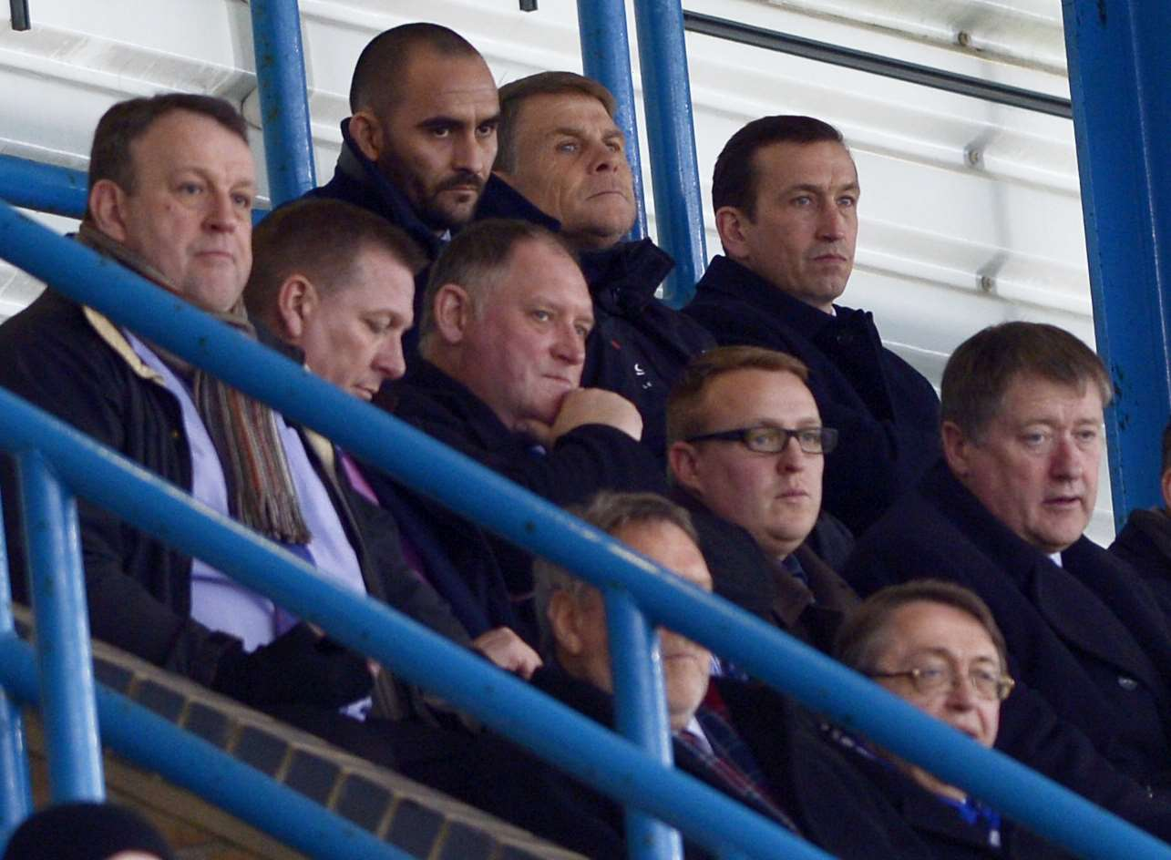 Justin Edinburgh watches from the stands alongside Andy Hessenthaler as the Gills beat Sheffield United 2-0 Picture: Barry Goodwin